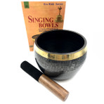 """6"""" diameter, 5"""" high Black bowl with brass rim.  Comes with round cushion and striker.  Made in Nepal"""