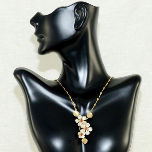 "Survivor Tree Necklace. Sterling silver accented with garnet. 18"" adjustable 18K gold vermeil chain"