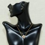 "Survivor Tree necklace. Sterling silver accented with garnet. 16"" adjustable 18K gold vermeil chain"