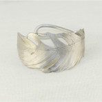"""Feather cuff.Hand patinated bronze, with silver finish 1.5"""" wide"""