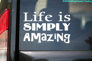 "White custom vinyl decal of ""Life is Simply Amazing"" applied to the rear window of a vehicle."