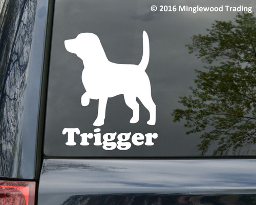 "White silhouette of a beagle with the custom name ""Trigger"" below, applied to the rear window of a minivan. Custom vinyl decal by Minglewood Trading."