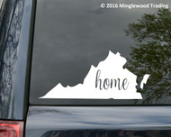 White custom vinyl decal sticker of the shape of the state of Virginia with the word home is script inside. Applied to the rear window of a minivan. By Minglewood Trading.