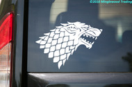 House Stark sigil custom vinyl decal of a dire wolf's head. Decal is applied to the rear windshield of a car.