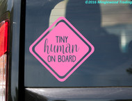 Soft pink Tiny Human on Board custom vinyl decal by Minglewood Trading. Applied to the rear window of an SUV.