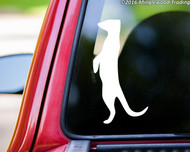 White custom vinyl decal of a meerkat. By Minglewood Trading. Applied to the rear window of a pickup truck.