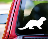 White custom vinyl decal of an otter. By Minglewood Trading. Applied to the rear window of a pickup truck.