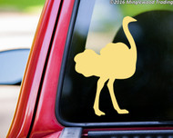 Light brown custom vinyl decal of an ostrich. By Minglewood Trading. Applied to the rear window of a pickup truck.