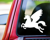 White custom vinyl decal of a pegasus. By Minglewood Trading. Applied to the rear window of a pickup truck.