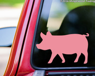Soft pink custom vinyl decal of a pig. By Minglewood Trading. Applied to the rear window of a pickup truck.