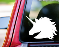 White custom vinyl decal of a unicorn head. By Minglewood Trading. Applied to the rear window of a pickup truck.