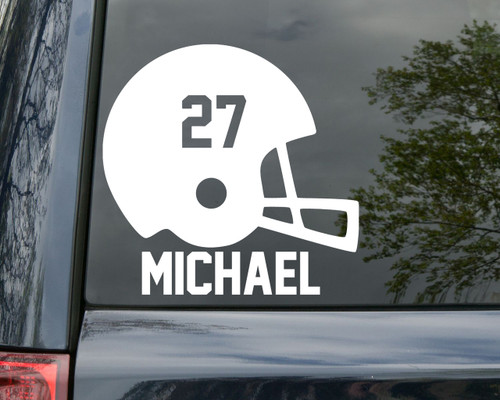 White football helmet with the number 27 custom vinyl decal. The name MICHAEL below the helmet. By Minglewood Trading. Applied to the rear window of a minivan.