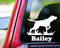 White silhouette of a Bird Dog / German Shorthaired Pointer custom vinyl decal with the name Bailey below. By Minglewood Trading. Applied to the rear window of a truck.