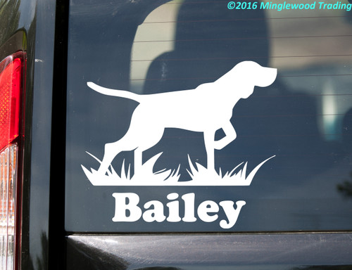 White silhouette of a Bird Dog / German Shorthaired Pointer custom vinyl decal with the name Bailey below. By Minglewood Trading. Applied to the rear window of a van.