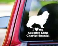 "White custom vinyl decal of a Cavalier King Charles Spaniel sitting with the words ""I love (heart symbol) my Cavalier King Charles Spaniel"" beneath. By Minglewood Trading. Applied to the rear window of a pickup truck."