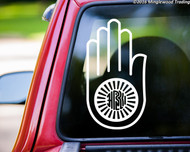 Custom white vinyl decal of the Ahisma Hand by Minglewood Trading. Applied to the rear window of a truck.