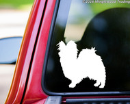 custom white vinyl decal of a Papillon / Continental Toy Spaniel dog  silhouette by Minglewood Trading. Applied to the rear window of an truck.