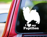 """White custom vinyl decal of a Papillon / Continental Toy Spaniel sitting with the words """"I love (heart symbol) my Papillon"""" beneath. By Minglewood Trading. Applied to the rear window of a pickup truck."""