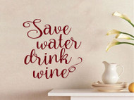 "Custom burgundy vinyl decal of  ""Save Water Drink Wine by Minglewood Trading. Applied to an interior wall of a cozy home."