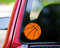 Custom orange vinyl decal of a basketball by Minglewood Trading. Applied to the rear window of an truck.