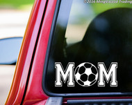 Custom white vinyl decal of Soccer Mom (two 'M's with a soccer ball between) by Minglewood Trading. Applied to the rear window of an truck.