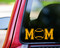 Custom yellow vinyl decal of Baseball Mom (two 'M's with a baseball between) by Minglewood Trading. Applied to the rear window of an truck.