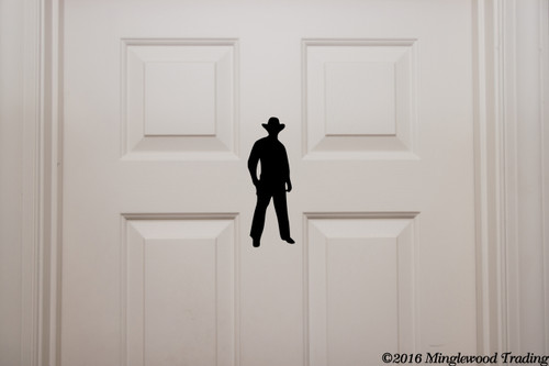 Custom black vinyl decal of a Cowboy by Minglewood Trading. Applied to an interior door.
