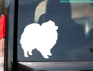 White custom vinyl decal sticker of a Pomeranian. By Minglewood Trading. Applied to the rear window of a minivan.