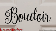 "Close-up of custom black vinyl decal of ""Boudoir"" in the Nouradilla font by Minglewood Trading.  Applied to an interior door."