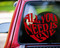 """Red custom vinyl decal of a Beatles quote - """"All You Need is Love"""" stylized into a heart shape. By Minglewood Trading.  Applied to the rear window of an truck."""