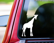 White custom vinyl decal sticker of a giraffe applied to the rear window of a truck.