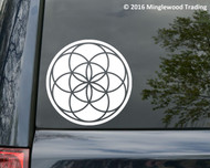 White custom vinyl decal of a Seed of Life design. By Minglewood Trading.  Applied to the rear window of a minivan