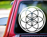 White custom vinyl decal of a Seed of Life design. By Minglewood Trading.  Applied to the rear window of a truck.