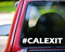 White custom vinyl decal sticker of hashtag CALEXIT (#CALEXIT) applied to the rear window of a truck.