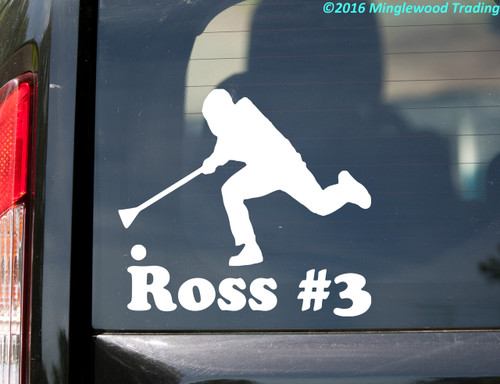 White custom vinyl decal sticker of a broomball player with the name Ross and #3 underneath, by Minglewood Trading. Applied to the rear window of a suv.