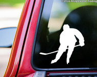 White custom vinyl decal of a hockey player. By Minglewood Trading. Applied to the rear window of a truck.