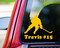 Yellow custom vinyl decal sticker of a broomball player with the name Travis and #15 underneath, by Minglewood Trading. Applied to the rear window of a truck