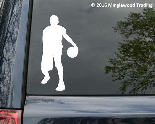 White custom vinyl decal of a male basketball player. By Minglewood Trading. Applied to the rear window of a minivan.