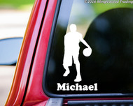 "White custom vinyl decal of a male basketball player with the personalized name ""Michael"" below. By Minglewood Trading. Applied to the rear window of a truck."