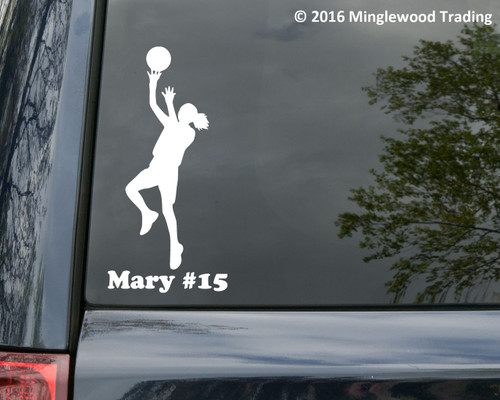 "White custom vinyl decal of a female basketball player with the personalized name ""Mary #15"" below. By Minglewood Trading. Applied to the rear window of a minivan."