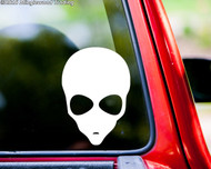 "Small (5"" tall) white Alien  Head custom vinyl decal applied to the rear window of a pickup truck."