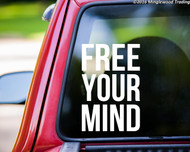 """Large (11"""" tall) white FREE YOUR MIND custom vinyl decal applied to the rear window of a truck."""