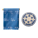 blue white snowflake towel and trivet