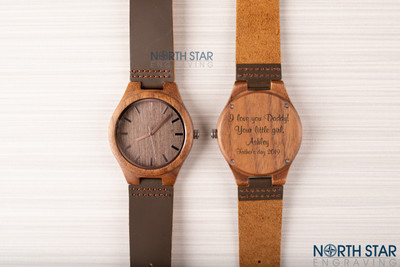 This Brown Leather watch can be personalized with your own message.   Font shown is the Mural Script font.