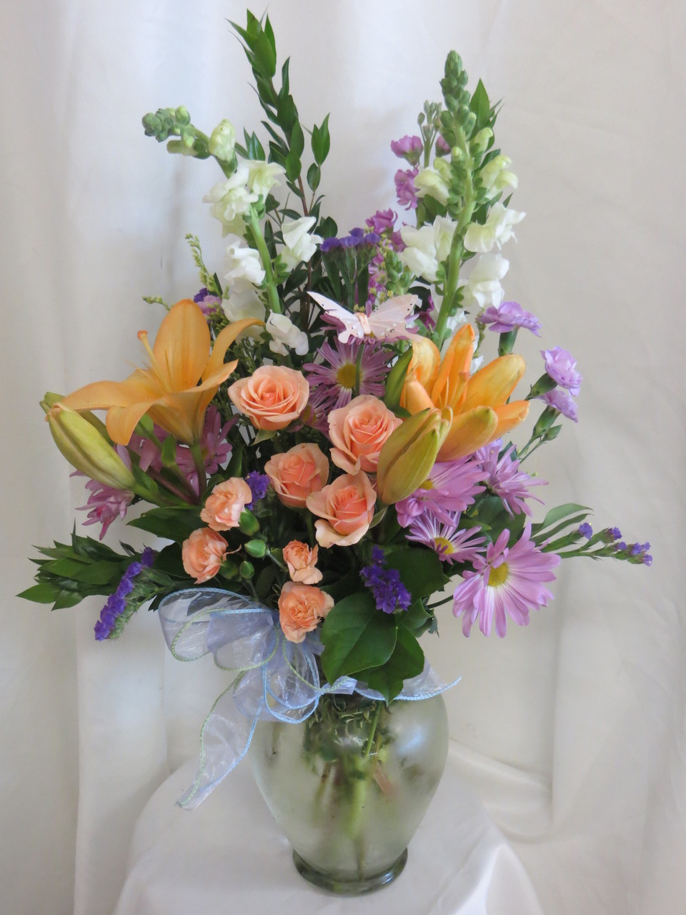 Your pasadena florist offers daily delivery of beautiful flowers in the moonlight orange lily and rose bouquet by enchanted florist pasadena texas flowers and izmirmasajfo
