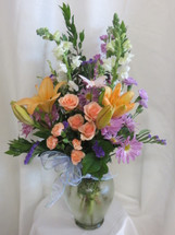 In the Moonlight Orange Lily and Rose Bouquet by Enchanted Florist Pasadena Texas - Flowers and plants delivered daily in Houston TX, Clear Lake, Webster and surrounding areas. Real flowers from a Pasadena florist. RM122