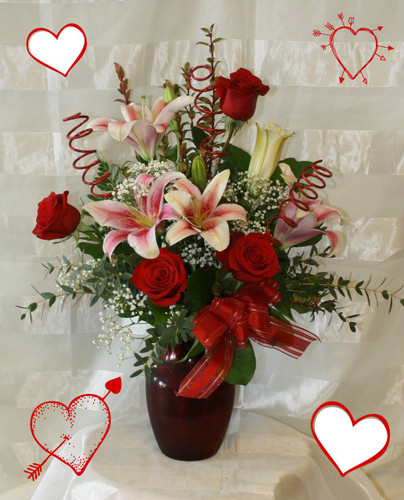 My Heart is Yours this Valentines Day by Enchanted Florist. Nothing says love like a romantic bouquet of star gazer lilies and red roses in a red vase with baby's breath. Also includes 3 glitter spadoodle sticks. Show her you're heart belongs to her this Valentines Day. RM934