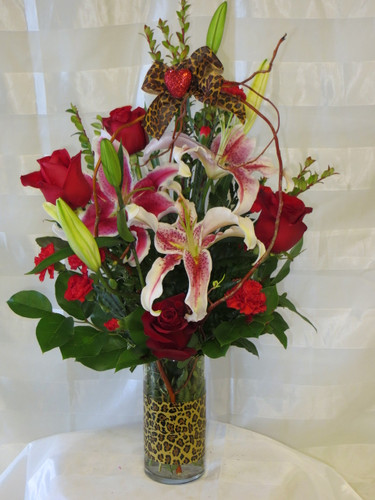 Jungle Love Red Rose and Stargazer Bouquet by Enchanted Florist Pasadena TX - Love and romance flowers with red roses delivered in Houston Texas and surrounding areas. RM137
