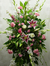 Tribute in Pink Sympathy Spray by Enchanted Florist Pasadena TX - funeral wreath or funeral spray in shades of pinks and whites including stargazer lilies, gladiola, roses, and carnations. Daily delivery to Houston local funeral homes. RM504
