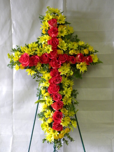 Rose Hope Funeral Cross by Enchanted Florist Pasadena TX. Hot pink roses and yellow daises in the shape of a funeral cross. Other colors available, just call. Funeral flowers have same day delivery to all local Pasadena and Houston funeral homes. Best florist in Pasadena TX for you sympathy flower needs. RM508